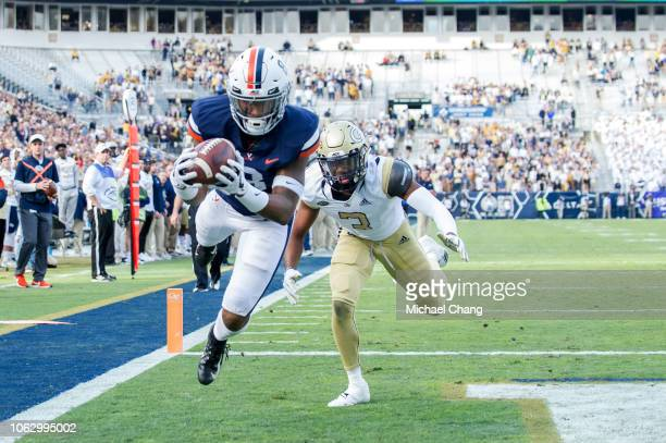 Wide receiver Hasise Dubois of the Virginia Cavaliers catches a pass for a touchdown in front of defensive back Tre Swilling of the Georgia Tech...