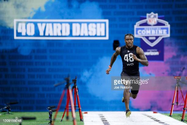 Wide receiver Henry Ruggs III of Alabama runs the 40yard dash during the NFL Scouting Combine at Lucas Oil Stadium on February 27 2020 in...