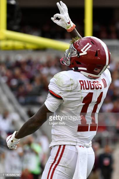 Wide receiver Henry Ruggs III of the Alabama Crimson Tide celebrates after a touchdown against Texas A&M Aggies at Kyle Field on October 12, 2019 in...