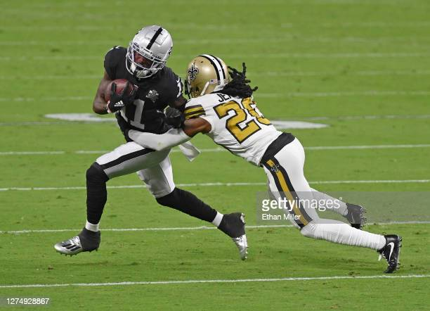 Wide receiver Henry Ruggs III of the Las Vegas Raiders is tackled by cornerback Janoris Jenkins of the New Orleans Saints during the first half of...