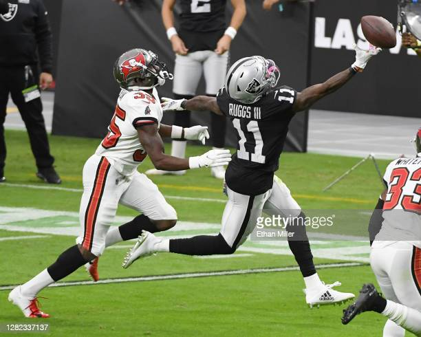 Wide receiver Henry Ruggs III of the Las Vegas Raiders misses a pass as cornerback Jamel Dean of the Tampa Bay Buccaneers defends during the second...