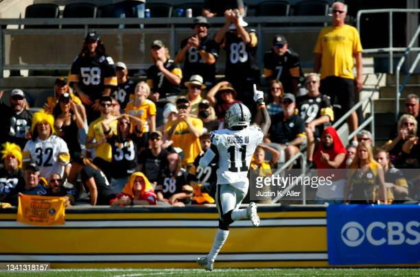 Wide receiver Henry Ruggs III of the Las Vegas Raiders runs after a catch for a touchdown in the fourth quarter of the game against the Pittsburgh...
