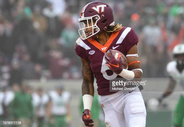 Wide receiver Hezekiah Grimsley of the Virginia Tech Hokies carries the ball following a reception against the Marshall Thundering Herd in the first...