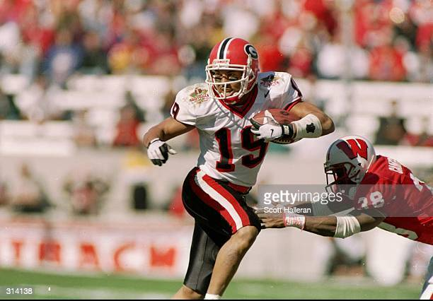 Wide receiver Hines Ward of the Georgia Bulldogs moves the ball during the Outback Bowl against the Wisconsin Badgers at Houlihan''s Stadium in...