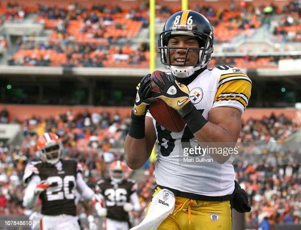 Wide receiver Hines Ward of the Pittsburgh Steelers catches a touchdown pass against the Cleveland Browns at Cleveland Browns Stadium on January 2...