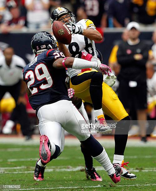 Wide receiver Hines Ward of the Pittsburgh Steelers drops the ball after taking a hard hit from cornerback Jason Allen and strong safety Glover Quin...
