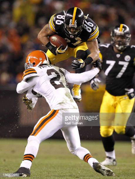 Wide receiver Hines Ward of the Pittsburgh Steelers jumps over defensive back Dimitri Patterson of the Cleveland Browns at Cleveland Browns Stadium...