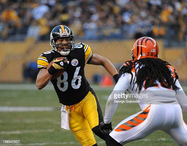 Wide receiver Hines Ward of the Pittsburgh Steelers runs with the football against safety Reggie Nelson of the Cincinnati Bengals after catching a...