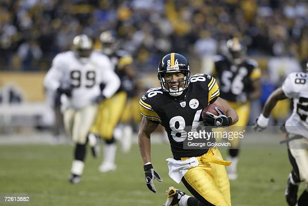 Wide receiver Hines Ward of the Pittsburgh Steelers runs with the football after catching a pass against the New Orleans Saints at Heinz Field on...
