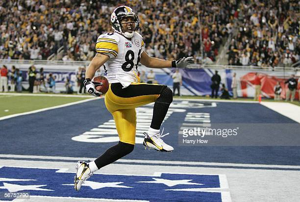 Wide receiver Hines Ward of the Pittsburgh Steelers scores a touchdown on a pass from receiver Antwaan Randle El in front of cornerback Marcus...