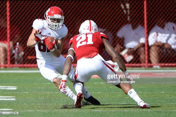 Wide receiver Hunter Hayek of the Rutgers Scarlet Knights tries to avoid the tackle from defensive back Lamar Jackson of the Nebraska Cornhuskers at...