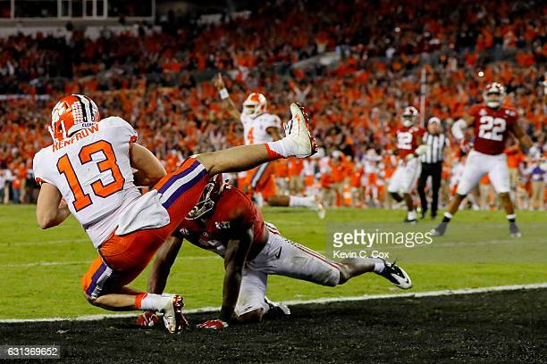Wide receiver Hunter Renfrow of the Clemson Tigers makes a 2yard gamewinning touchdown reception against defensive back Tony Brown of the Alabama...