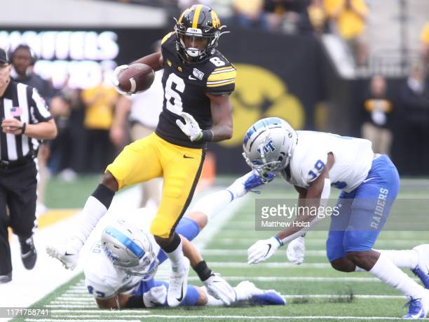 Wide receiver Ihmir Smith-Marsette of the Iowa Hawkeyes is taken out of bounds during the first half by linebacker Brett Shepherd and corner back...