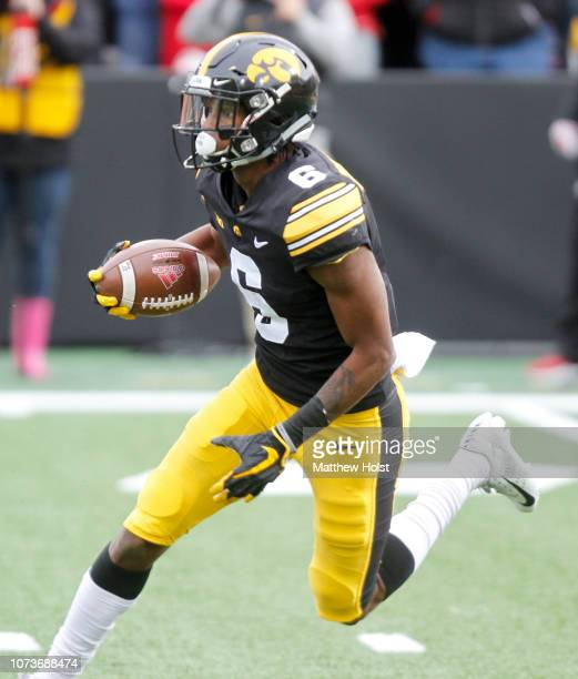 Wide receiver Ihmir SmithMarsette of the Iowa Hawkeyes returns a kick in the first half against the Nebraska Cornhuskers on November 23 2018 at...