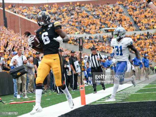 Wide receiver Ihmir Smith-Marsette of the Iowa Hawkeyes scores a touchdown during the second half in front of corner back Justin Brown of the Middle...