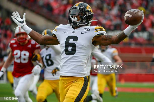 Wide receiver Ihmir SmithMarsette of the Iowa Hawkeyes scores on a kickoff return against the Nebraska Cornhuskers at Memorial Stadium on November 29...