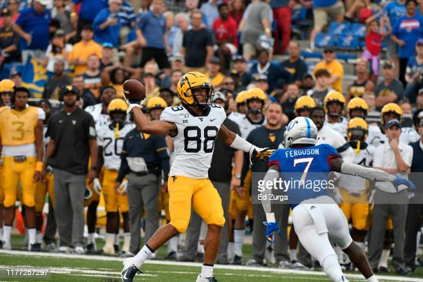 Wide receiver Isaiah Esdale of the West Virginia Mountaineers passes against the Kansas Jayhawks at Memorial Stadium on September 21 2019 in Lawrence...
