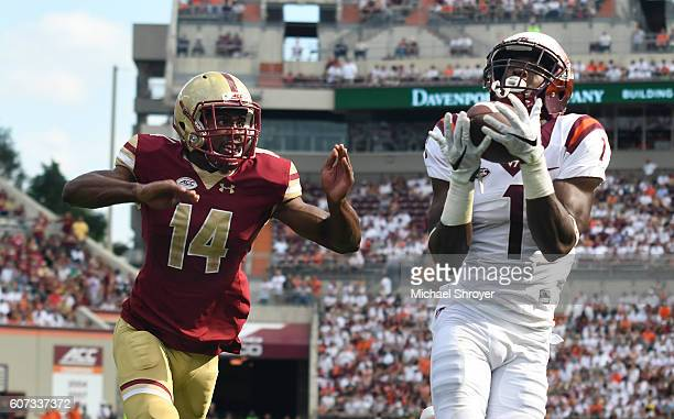 Wide receiver Isaiah Ford of the Virginia Tech Hokies catches a touchdown pass against the Boston College Eagles in the first half at Lane Stadium on...