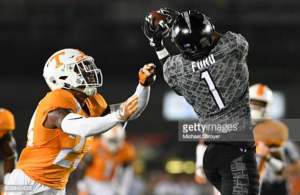 Wide receiver Isaiah Ford of the Virginia Tech Hokies is defended by Defensive back Cameron Sutton of the Tennessee Volunteers in the first half at...