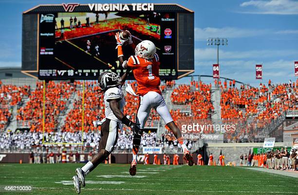 Wide receiver Isaiah Ford of the Virginia Tech Hokies makes a touchdown catch while being defended by cornerback Ronald Zamort of the Western...