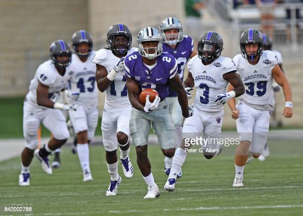 Wide receiver Isaiah Harris of the Kansas State Wildcats returns the opening kickoff 96 yards against the Central Arkansas Bears during the first...