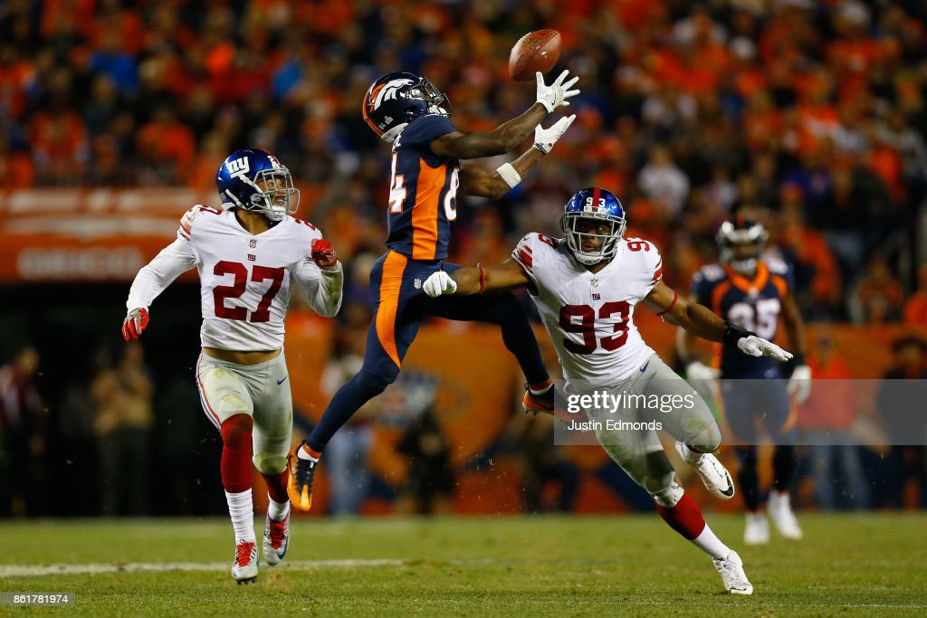 Wide receiver Isaiah McKenzie #84 of the Denver Broncos drops a pass and injure his ankle while being defended by free safety Darian Thompson #27 of the New York Giants and B.J. Goodson #93 during the fourth quarter at Sports Authority Field at Mile High on October 15, 2017 in Denver, Colorado. The Giants defeated the Broncos 23-10.