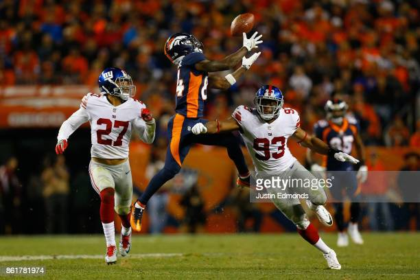 Wide receiver Isaiah McKenzie of the Denver Broncos drops a pass and injure his ankle while being defended by free safety Darian Thompson of the New...