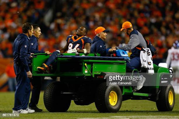 Wide receiver Isaiah McKenzie of the Denver Broncos is carted off the field after injuring his ankle during the fourth quarter against the New York...