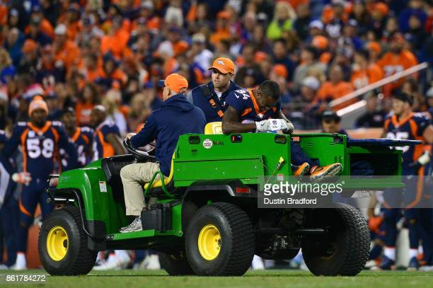 Wide receiver Isaiah McKenzie of the Denver Broncos is carted off the field after sustaining an injury in the fourth quarter of a game against the...