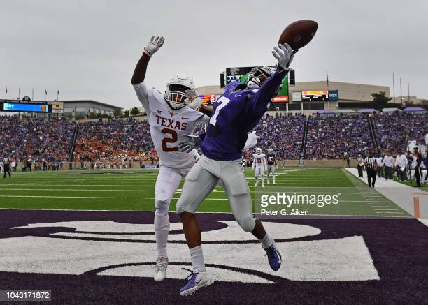 Wide receiver Isaiah Zuber of the Kansas State Wildcats can't hang on to a pass in the back of the end zone against defensive back Kris Boyd of the...