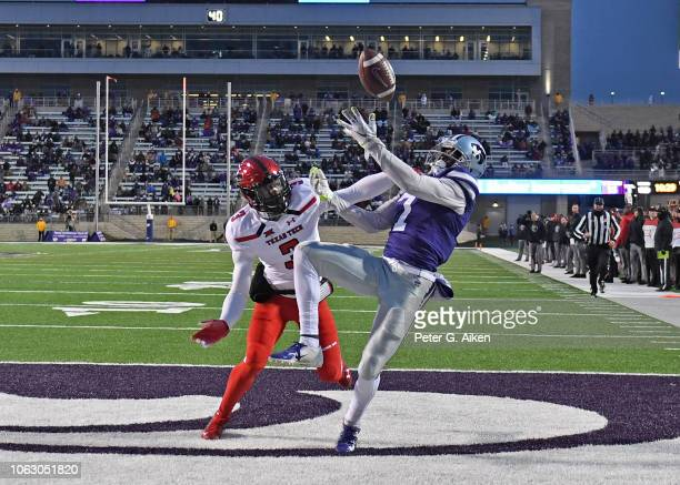 Wide receiver Isaiah Zuber of the Kansas State Wildcats has the pass in the end zone broken up by defensive back Douglas Coleman III of the Texas...