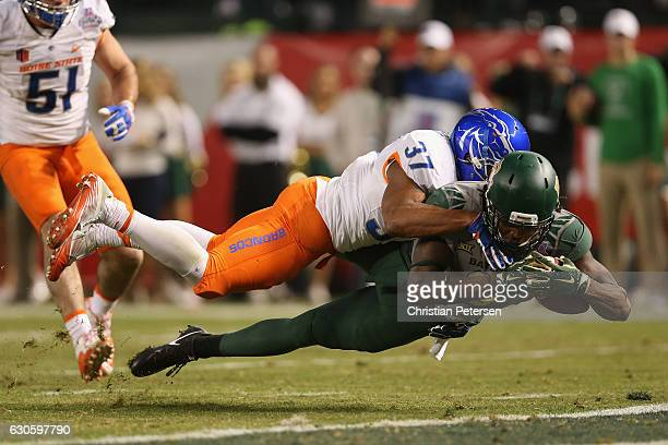 Wide receiver Ishmael Zamora of the Baylor Bears dives into the end zone under safety Cameron Hartsfield of the Boise State Broncos to score a 14...