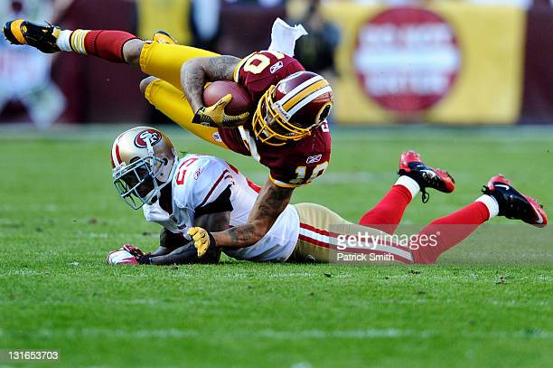 Wide receiver Jabar Gaffney of the Washington Redskins is tackled by cornerback Tarell Brown of the San Francisco 49ers in the second quarter at...