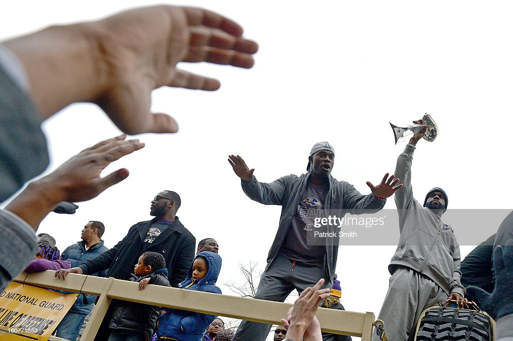 Wide receiver Jacoby Jones #12 of the Baltimore Ravens (center) waves to fans as he and teammates celebrate during their Super Bowl XLVII victory parade near M&T Bank Stadium on February 5, 2013 in Baltimore, Maryland. The Baltimore Ravens captured their second Super Bowl title by defeating the San Francisco 49ers.