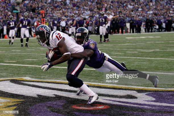 Wide receiver Jacoby Jones of the Houston Texans catches a touchdown pass in front of defender Ed Reed of the Baltimore Ravens during the second half...