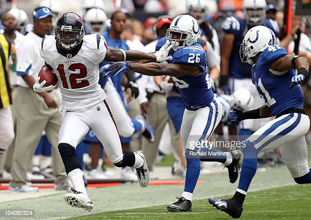 Wide receiver Jacoby Jones of the Houston Texans runs the ball past Kelvin Hayden of the Indianapolis Colts at Reliant Stadium on September 12 2010...