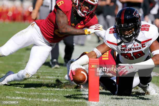 Wide receiver Ja'Deion High of the Texas Tech Red Raiders is knocked out of bounds on the one yard line by defensive back De'Monte Ruth of the Iowa...