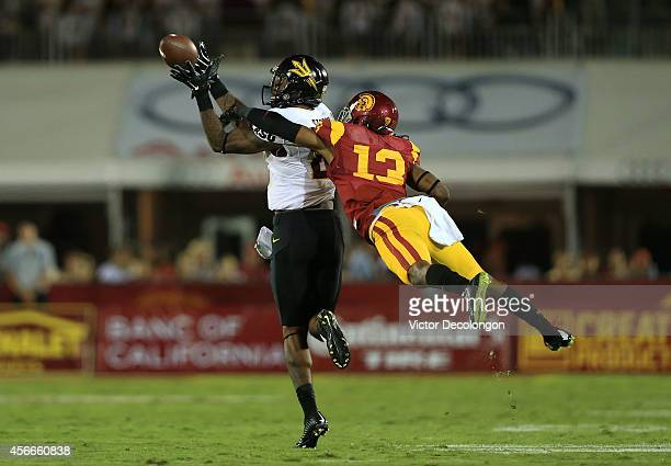 Wide receiver Jaelen Strong of the Arizona State Sun Devils catches the ball for a reception as cornerback Kevon Seymour of the USC Trojans can't...