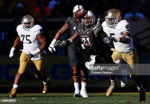 Wide receiver Jaelen Strong of the Arizona State Sun Devils is unable to catch a pass ahead of linebacker Nyles Morgan of the Notre Dame Fighting...