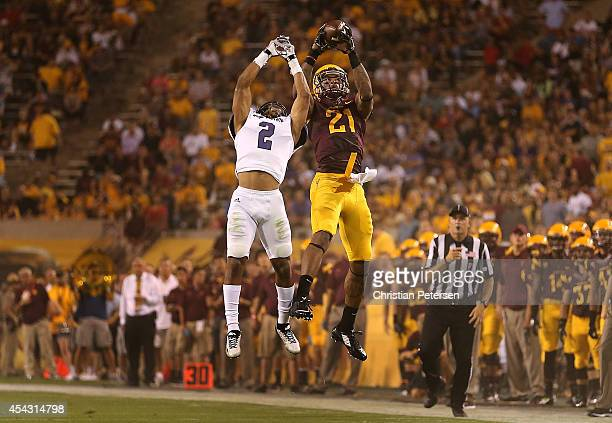 Wide receiver Jaelen Strong of the Arizona State Sun Devils makes a leaping 35 yard reception over cornerback Cordero Dixon of the Weber State...