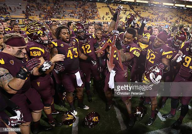 Wide receiver Jaelen Strong of the Arizona State Sun Devils spikes the pitch fork in celebration after the college football game against the USC...