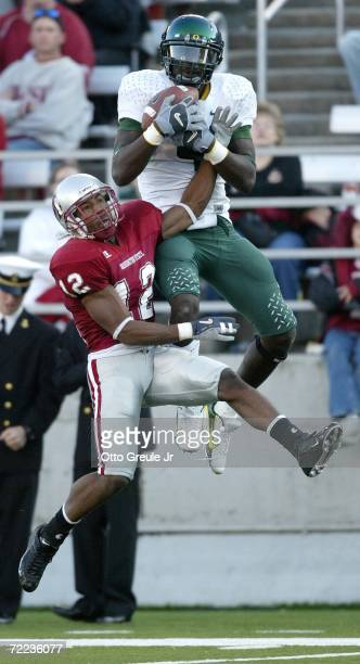 Wide receiver Jaison Williams of the Oregon Ducks makes a leaping catch against Tyron Brackenridge of the Washington State Cougars on October 21 2006...