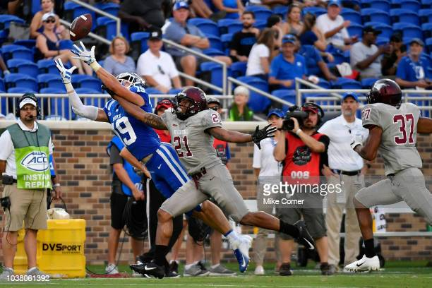 Wide receiver Jake Bobo of the Duke Blue Devils lays out for a long reception over defensive back Daryl Smith of the North Carolina Central Eagles...