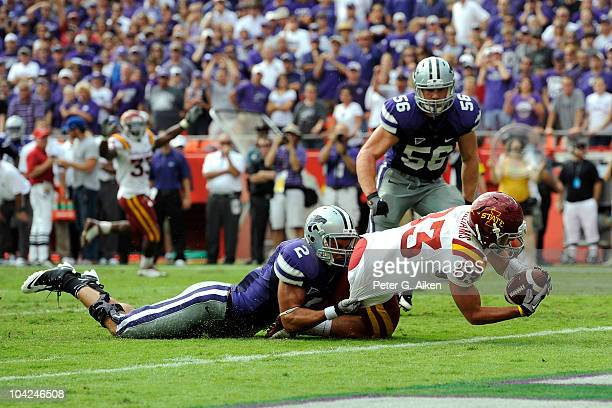Wide receiver Jake Williams of the Iowa State Cyclones dives into the end zone for a 13 yard touchdown as safety Tysyn Hartman of the Kansas State...