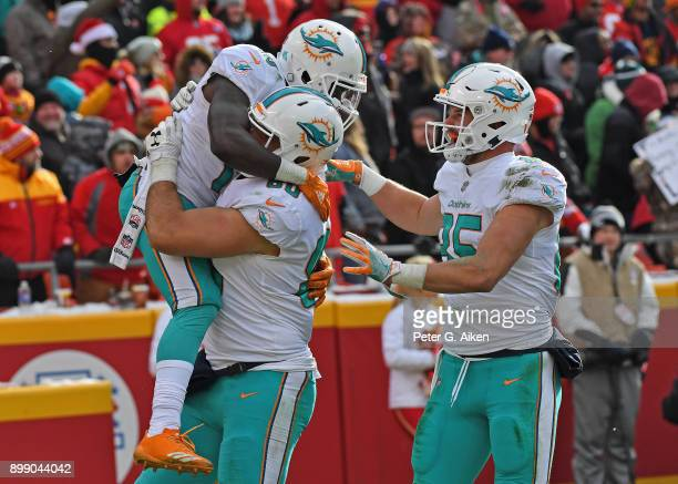Wide receiver Jakeem Grant of the Miami Dolphins celebrates with teammates after scoring a touchdown against the Kansas City Chiefs during the first...