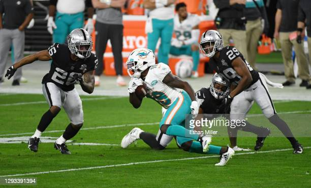 Wide receiver Jakeem Grant of the Miami Dolphins runs against cornerback Nevin Lawson, middle linebacker Raekwon McMillan and free safety Lamarcus...
