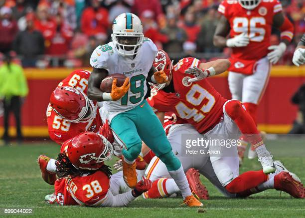 Wide receiver Jakeem Grant of the Miami Dolphins runs through Kansas City Chiefs defenders for a touchdown during the first half of the game at...