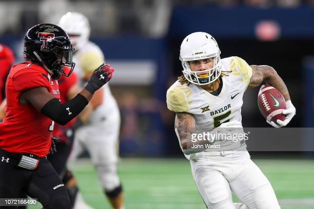Wide receiver Jalen Hurd of the Baylor Bears tries to get past linebacker Jordyn Brooks of the Texas Tech Red Raiders during the game on November 24...