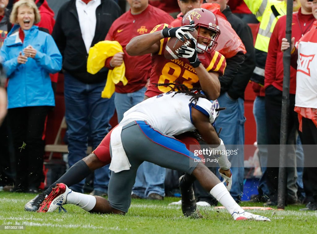 Wide receiver Jalen Martin #83 of the Iowa State Cyclones is tackled by cornerback Shakial Taylor #8 of the Kansas Jayhawks as he rushed for yards in the second half of play at Jack Trice Stadium on October 14, 2017 in Ames, Iowa. The Iowa State Cyclones won 45-0 over the Kansas Jayhawks.