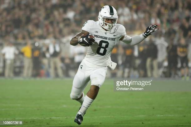 Wide receiver Jalen Nailor of the Michigan State Spartans carries the football after a reception against the Arizona State Sun Devils during the...